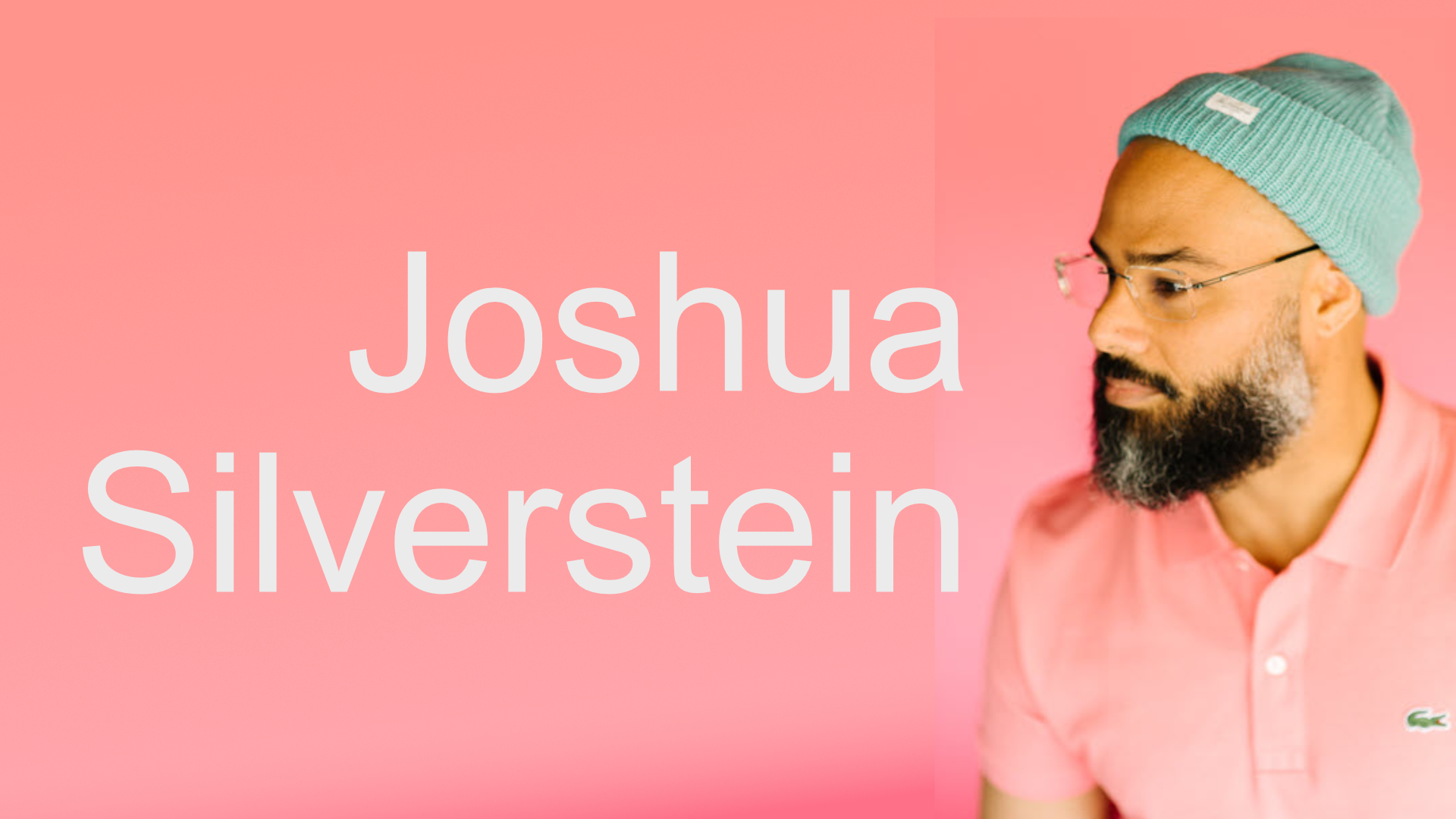 Picture of Joshua Silverstein. Man with beard wearing a pink hat and shirt.