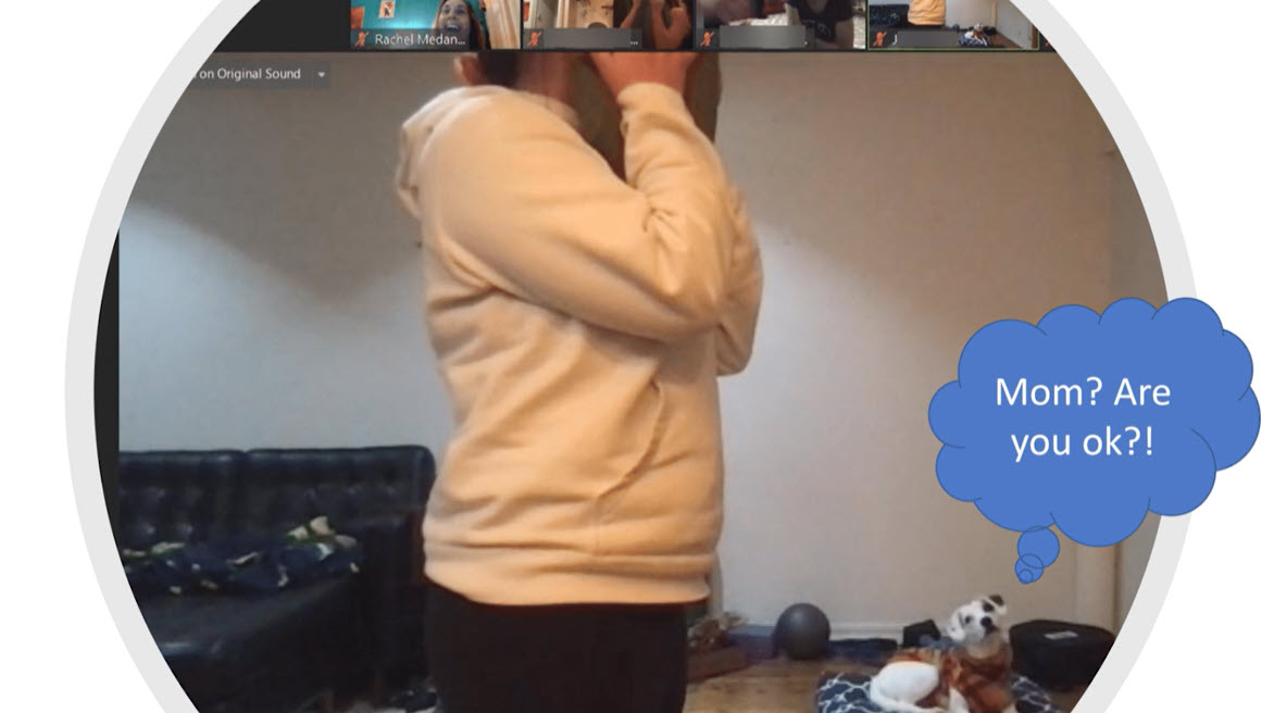 Screenshot of a Zoom meeting with woman holding a pillow over her face in the center while her dog looks on behind her with a puzzled look on its face.