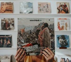 Hands on a Woodstock vinyl album